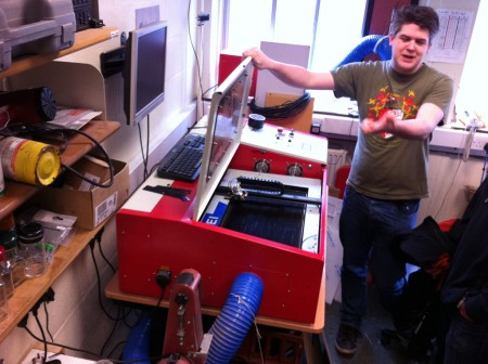 Ted explains to the Software Society how to operate the laser cutter with the lid open.